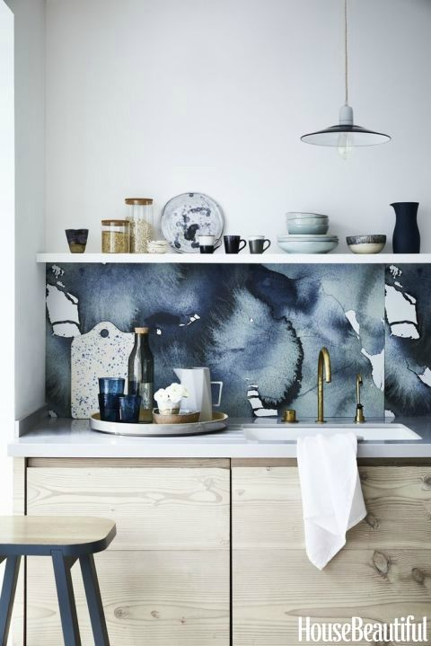 This stunning marbled wall panel is a dramatic focal point in a simply chic kitchen. For more ways on how to decorate using glorious inky blue hues in your home, visit housebeautiful.co.uk. (Styling by Sally Denning and Photography by Mark Scott).