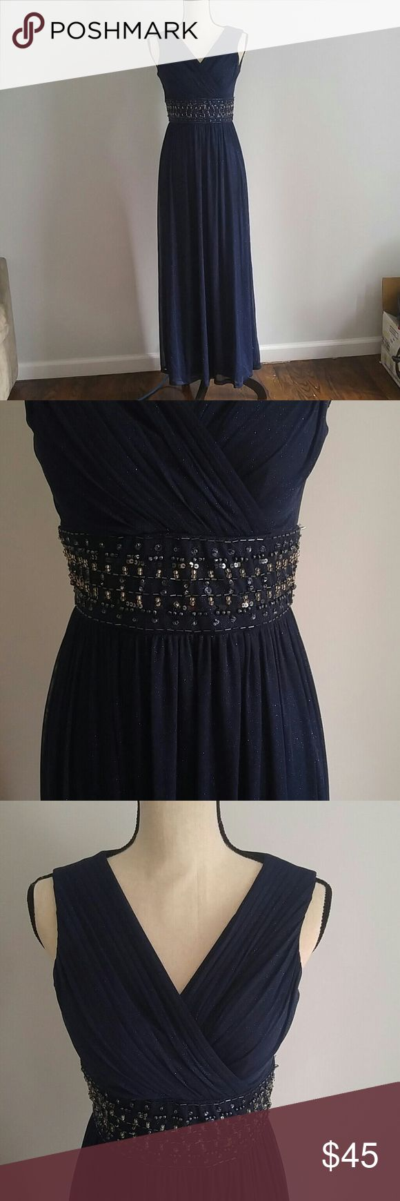"""Bridesmaid prom mother of bride dress Size 4 petite dress that is a sparkly navy blue with a beaded band around the waist. Bought from Macy's. I got this dress when i was a bridesmaid and will probably never wear it again. It has not been altered and is in good condition! Perfect for a future bridesmaid, conservative prom dress, mother of the bride, or a ball. It is very pretty I have since lost weight so it not longer fits! Make me an offer or add to a bundle! :) * 52 inches / 4'4"""" in…"""