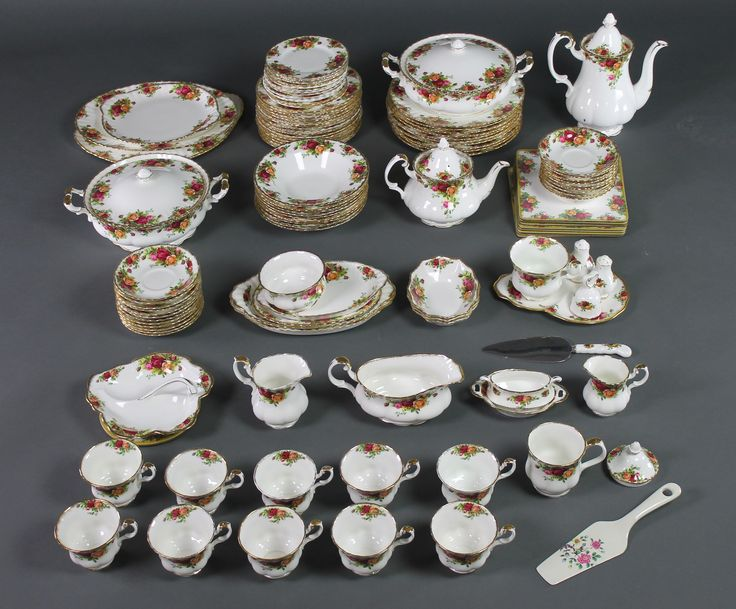 Lot 134, A Royal Albert Old Country Roses tea and dinner service comprising 2 tureens and covers, 10 dinner plates, 15 side plates, 13 small plates, 9 soup bowls, 6 serving dishes, a gravy boat, teapot, coffee pot, cream jug, milk jug, 11 tea cups, 21 saucers, 3 small dishes, sugar bowl, 2 handled dish, squat bowl, hors d'oeuvres dish, teacup and stand, 2 condiments, a bell, cake slice, table mats, stand, est. £200-300