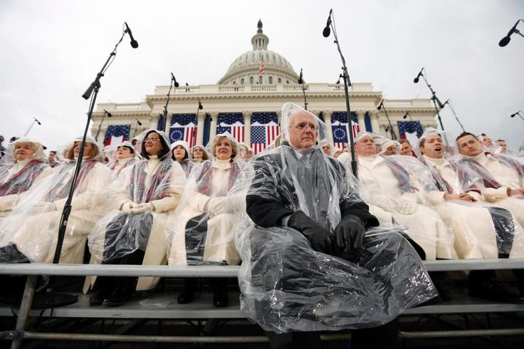 Members of the Mormon Tabernacle Choir sit in the rain waiting for the swearing in of Donald Trump as the 45th president of the United States to begin during at the U.S. Capitol in Washington.