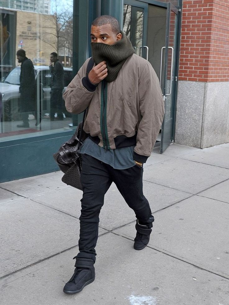 Kanye West Wears Haider Ackermann Jacket, Maison Martin Margiela Sneakers  and Carries Bottega Veneta Bag