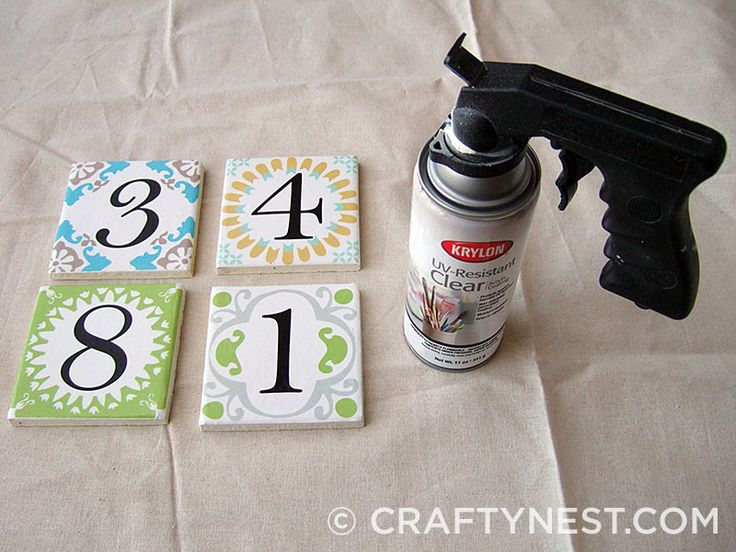 DIY house number (she designed printable numbers, affix to plain tile with outdoor mod podge. Done!