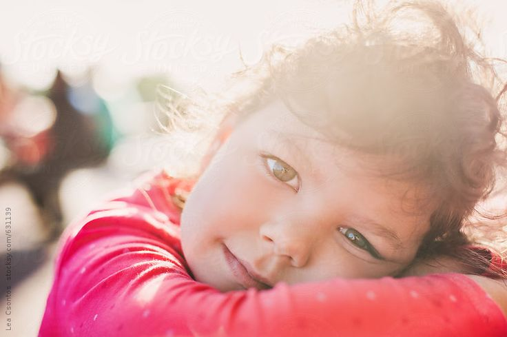 Closeup portrait of a cute girl with gorgeous backlight at sunset - Lea Csontos for Stocksy United