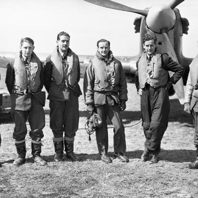 Pilots of No 43 Squadron RAF based at Wick, Caithness, standing in front of one of the unit's Hawker Hurricane Mark Is. Left to right: Sergeants J Arbuthnot, R Plenderleith and H J L Hallows, Flying Officer J W Simpson, Flight Lieutenant P W Townsend and Pilot Officer H C Upton. April 1940. (IWM)
