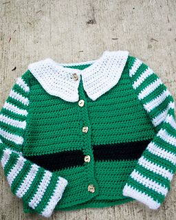 A free Christmas cardigan pattern for baby, so you can have a little helper for all of your holiday tasks. Crocheted from the bottom up with minimal seaming, the body is one piece and the sleeves are crocheted in the round. The collar is crocheted on, so the only seaming is to set the sleeves in. A quick project that you can complete for all of your holiday photos :)