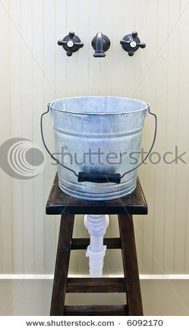 Just put the galvanized tub sink on a barstool! would be cool in the mud room or outside. love it