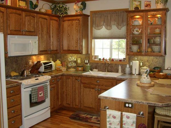 image of country kitchen with oak cabinets and picture of