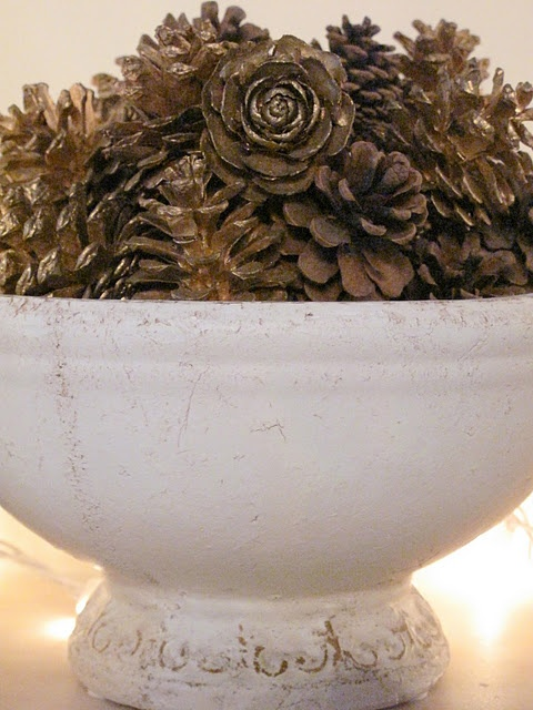Simple centerpiece: Fill a bown with pine cones and dust with gold or silver dust.  Or, choose gilt cones from a craft store.