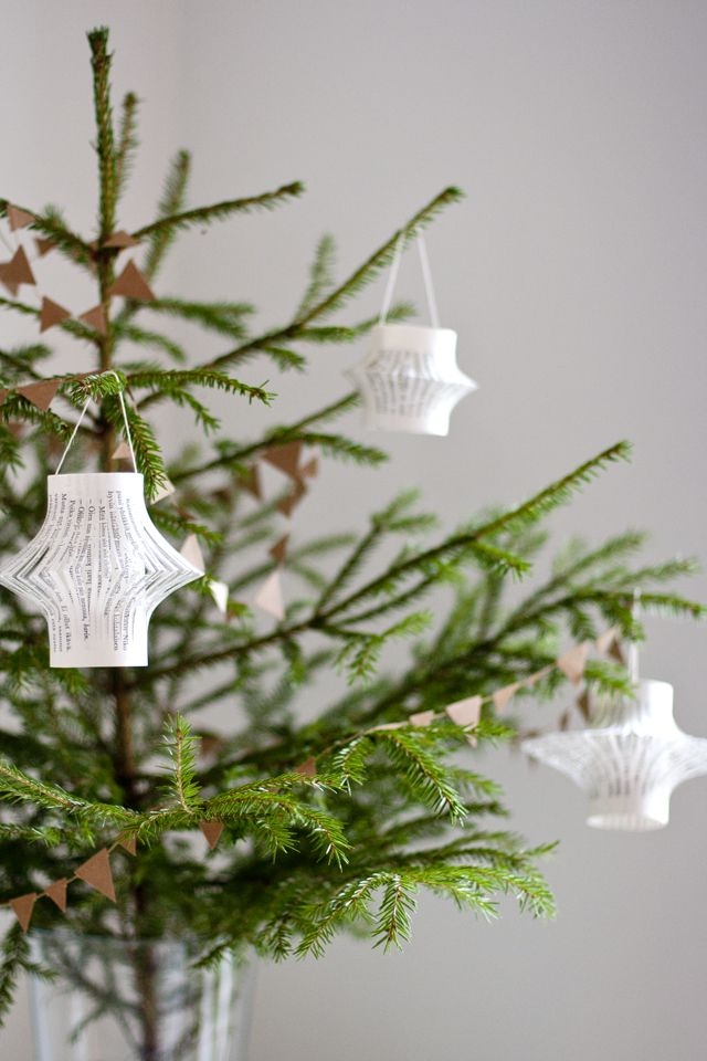 UKKONOOA: kierrätys. Book paper lanterns on baby fir tree. Scroll halfway down the post.
