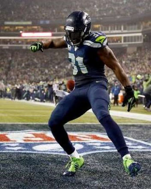 Kam Chancellor of the Seattle Seahawks celebrates after scoring on a 90-yard interception return against the Carolina Panthers the 2015 NFC Divisional Playoff game Jan. 10 in Seattle. Seattle won 31-17.