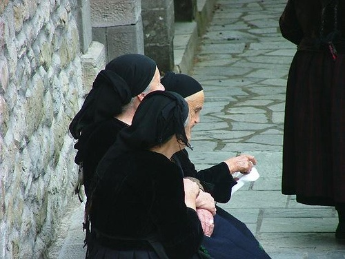 Old women waiting outside the church in Metsovo, Greece