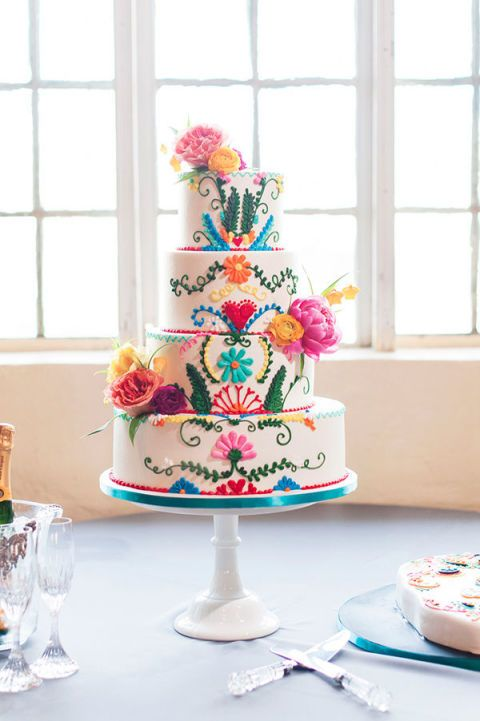 What's a grown-up version of a piñata? This bright and colorful design for a fiesta-themed wedding (genius) designed by Amy Cakes. See more at Ely Fair Photography »