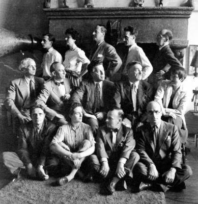 """""""Artists in Exile"""", Peggy Guggenheim's apartment, New York, 1942. Front row: Stanley William Hayter, Leonara Carrington, Frederick Kiesler, Kurt Seligmann. Second Row: Max Ernst, Amedee Ozenfant, Andre Breton, Fernand Leger, Berenice Abbott. Third Row: Jimmy Ernst, Peggy Guggenheim, John Ferren, Marcel Duchamp, Piet Mondrian. Photograph: The Philadelphia Museum of Art, Philadelphia, Pennsylvania."""