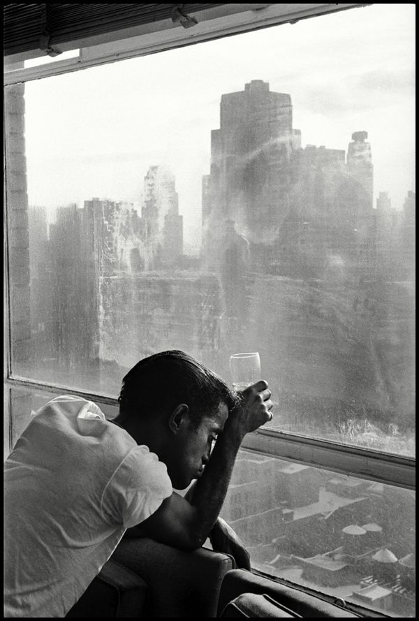 Burt GLINN :: Sammy Davis Jr. looking out a Manhattan window at dawn / NYC, 1959