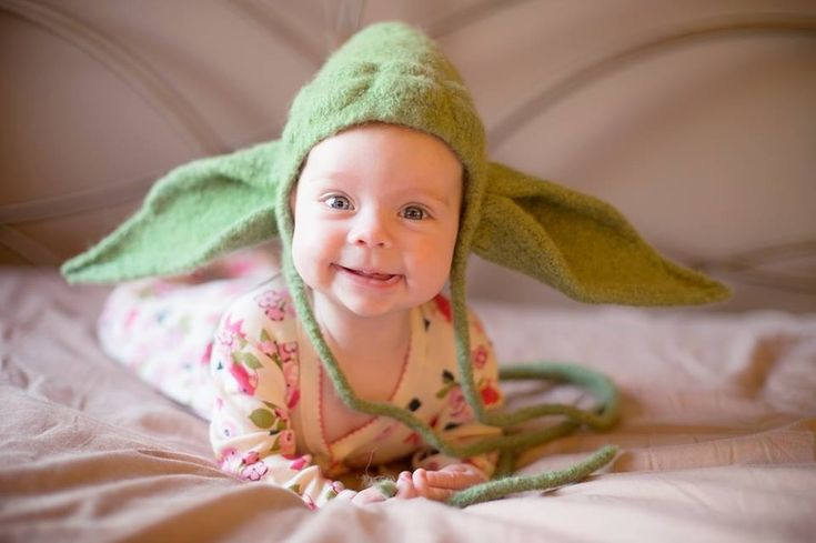 Friend knitted our daughter a yoda hat. - gotta try to make this. and this baby is so fn adorable!