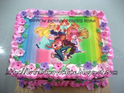Winx Club cake - she likes Winx, the flowers and the rainbow background... Maybe add slumber party theme (like make it a bed or a pillow fight??)