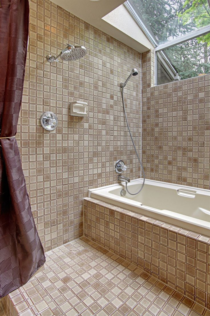Tropical Bathroom Design With Convertible Surround Bathtub And Shower Under Glass Sunroof Combined Brown Ceramic