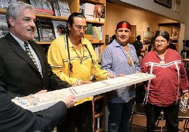 Gregg Tripoli (left), executive director of the Onondaga Historical Association, returns a wampum belt that has been in the museum's possession to Tadoda´ho Sid Hill, Onondaga spiritual leader; Jake Edwards, a member of the council of chiefs; and Tony Gonyea, an Onondaga faithkeeper.