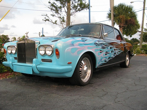Rolls-Royce...  Interesting paint, but in my taste way out of place on such a fine example of classic Coachmanship.  Like a Beatles bad acid trip into the irony of rock star excess and self-important egoism.  Imagine appreciating the craft of Rolls-Royce unadulterated...  you whoooo...  you can say I'm a dreamer, but I'm not the only one.