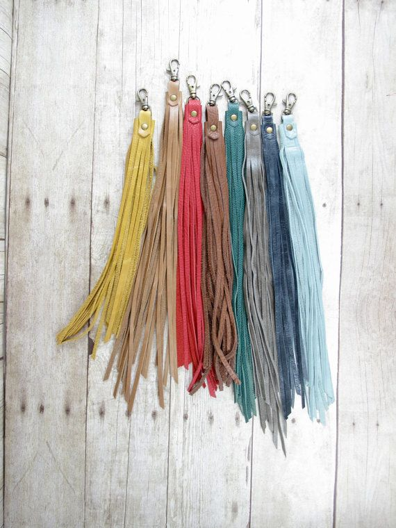 These super fun long leather tassels are perfect for adding some colorful fringe to your favorite bag! -> Genuine Leather -> 9-11 inch Long Length ->Antique brass clip and rivet ->Handmade and one of a kind! Current colors available from right to left of the first photo: 1) Mustard 2) Tan 3) Cherry Tomato (Short only) 4) Brown 5) Forrest Green- not pictured 6) Taupe Grey (with a greenish hue) 7) Black Denim (very dark blue) SOLD OUT 8) Ice Blue 9) Black 10) Dark Brown 11) Rust Orange-not…