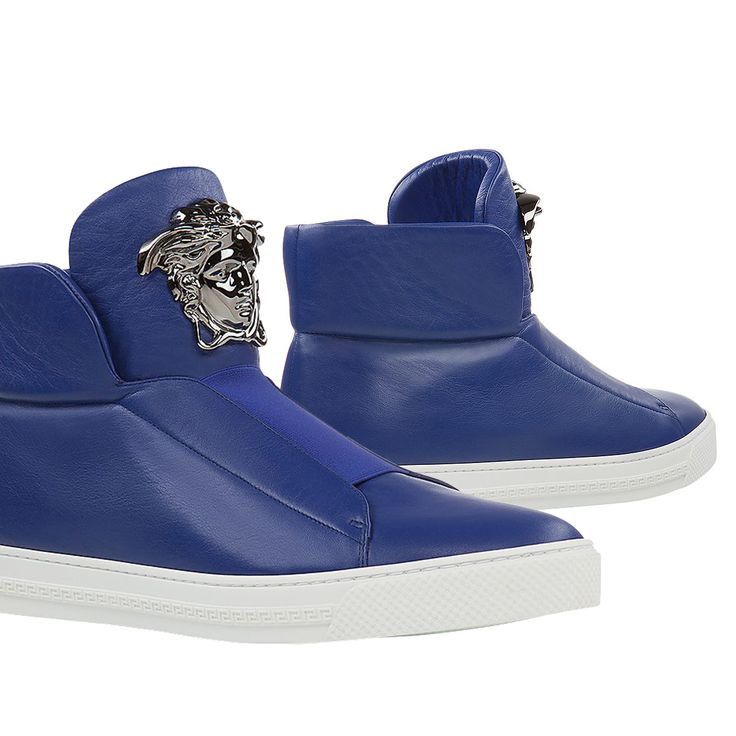 Go for a glorious style statement with these slip-on #Versace Palazzo sneakers in bright blue, embellished with a silver-tone Medusa Head.