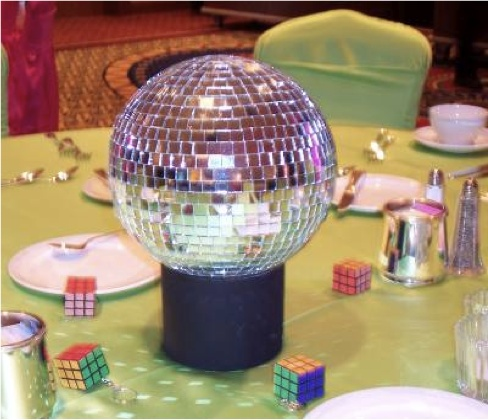 Green Linen With Disco Ball Centerpiece And Rubiku0027s Cube Decorations