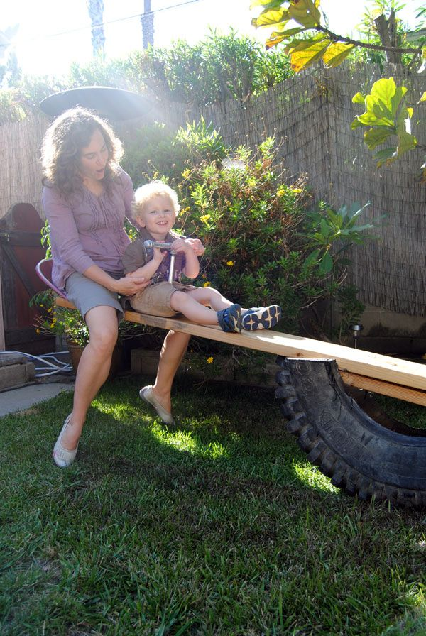 How To Build a Tire See Saw- think my Dad could knock this out in 30 minutes and entertain the grandkids for years.