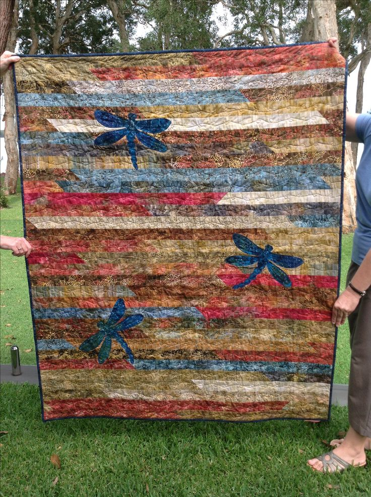 Jelly Roll Race quilt with dragonflys
