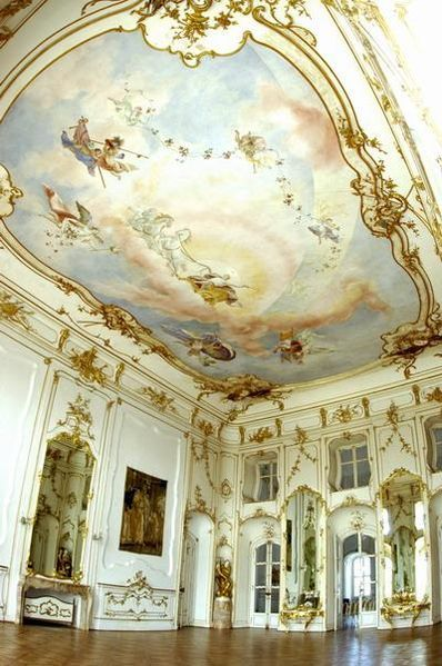 """Eszterhazy Palace, Hungary  Large reception hall.  This baroque-rococo """"Hungarian Versailles"""" was built between 1720 and 1766 for Miklos Esterhazy Fenyes, head of one of Hungary's wealthiest, aristocratic families. The Austrian composer Joseph Hayden lived here as a guest for nearly half of his active period, 1766 to 1790. It has 126 rooms. The ceiling of the Banquet Room see here has a painting of Apollo in his Chariot."""