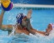 Tim Hutten (L) of the U.S. challenges Montenegro's Boris Zlokovic during their men's preliminary round Group B water polo match at the Water Polo Arena during the London 2012 Olympic Games