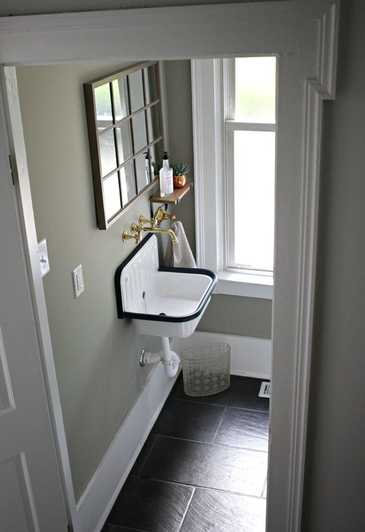 Bathroom remodel featuring Rejuvenation's utilitarian Alape Bucket Sink.