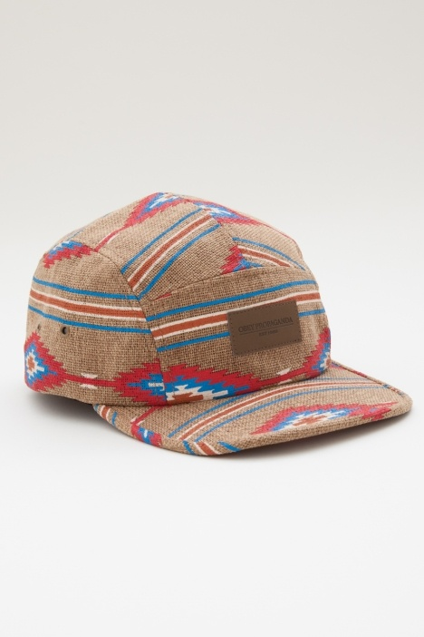 PRESCOTT 5 PANEL HAT    Five panel camp hat. All over Navajo print on Jute. Heat debossed leather patch with leather closure and antique brass buckle.    100% Polyester        Add to Favorites        Email to a Friend    $32.00