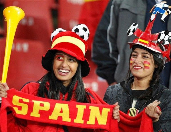 World Cup Spanish flag tattoo on eye and face - cute football hat