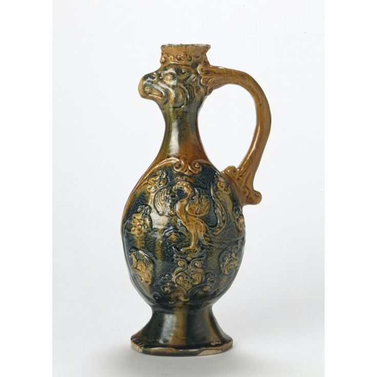 Bird - Headed Ewer  Date: Tang Dynasty (618 - 906)  Location: Shaanxi province or Henan province, China.  A ceramic piece brought to China from the Persian world. When trading with the Chinese, the Persians tried to replicate the Chinese porcelain but failed.