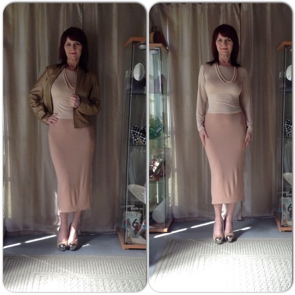 NEW 2 PC NUDE TONE SKIRT SET New 2 pc skirt set in nude tones. Simple design tube skirt midi length & elastic waist. Top has long sleeves with mock turtle neck. The fabric has stretch & lightweight so it is somewhat easy to see panty lines due to the color & fabric. I styled it with a pair of nude suede heels & gold lambskin jacket & vintage pearls. Super easy outfit to style! Skirts Midi
