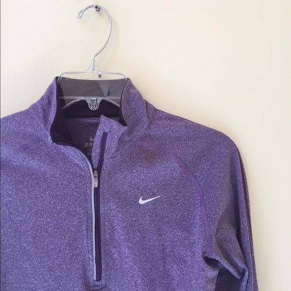 Nike quarter zip Really soft dri-fit quarter zip. Worn once, slight pulling on the seam but completely unnoticeable when wearing  Nike Tops