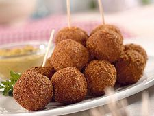"""Bitterbal (Meat Croquettes) recipe - The """"bitter"""" refers to the accompanying drink, not the appetizer. These are mild, crusty little balls to be dipped in tangy mustard."""