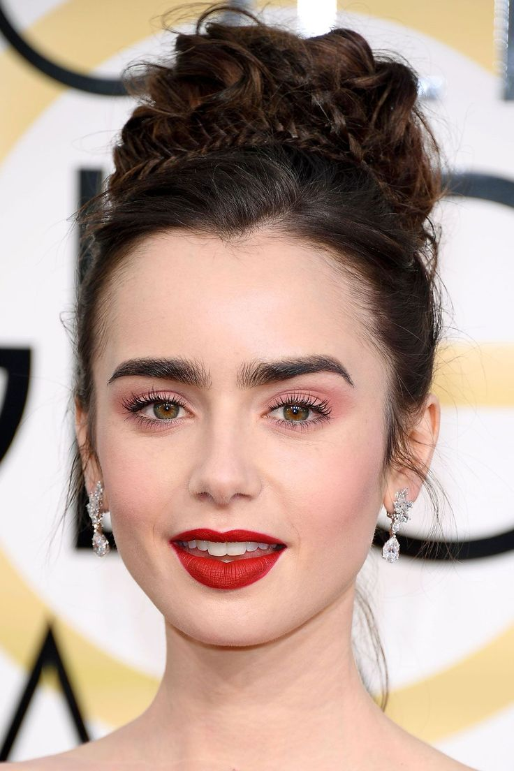 "The Best Beauty Looks From The Golden Globes  #refinery29  http://www.refinery29.com/2017/01/135131/golden-globes-2017-best-hair-makeup-photos#slide-12  Lily CollinsWe don't know which we love more: Lily Collins' Rapunzel-like bun or her millennial pink shadow and red lip combo. Dying to recreate the look? The actress' makeup artist, Fiona Stiles, used <a href=""ht..."