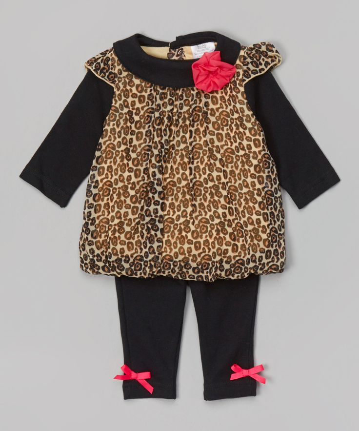 #Brown & Black Leopard Tunic & Leggings | zulily (Soft cotton and a ribbed neckline ensure a comfy fit, while frilly bows and ruffles add a girly touch.  Includes tunic and leggings Tunic self: 100% polyester Tunic contrast: 100% cotton Pants: 100% cotton Machine wash; tumble dry Imported)