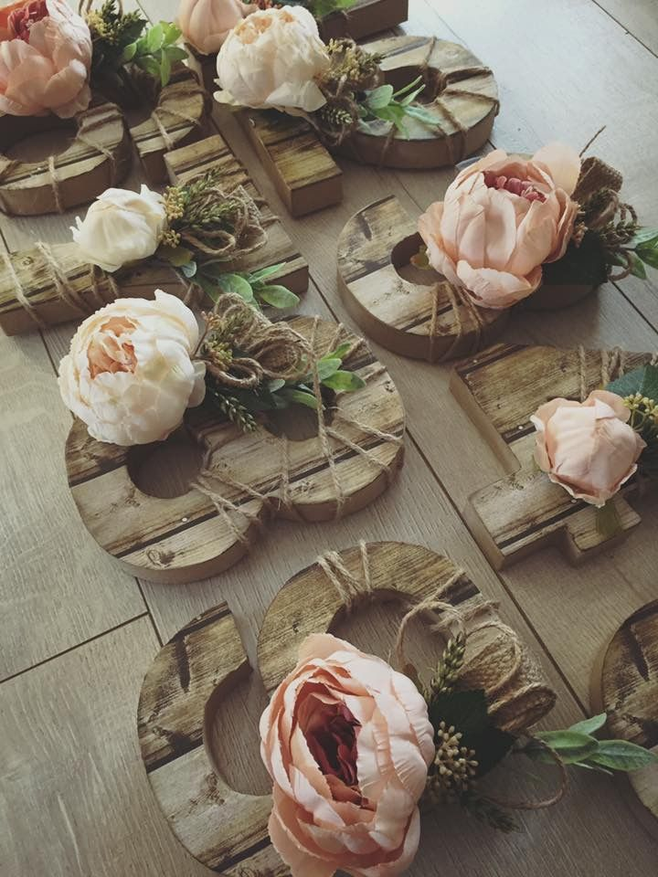 Rustic table numbers with faux flowers and faux wood paper complete with Peonies