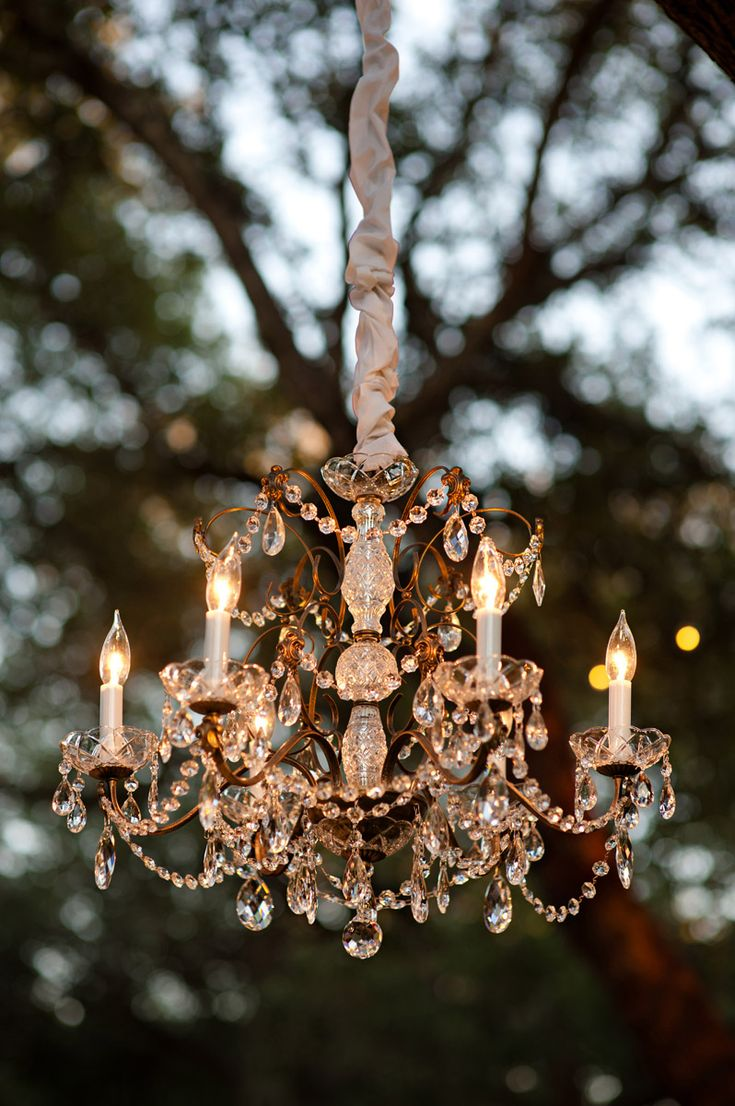 a stunning crystal chandelier for garden parties ...