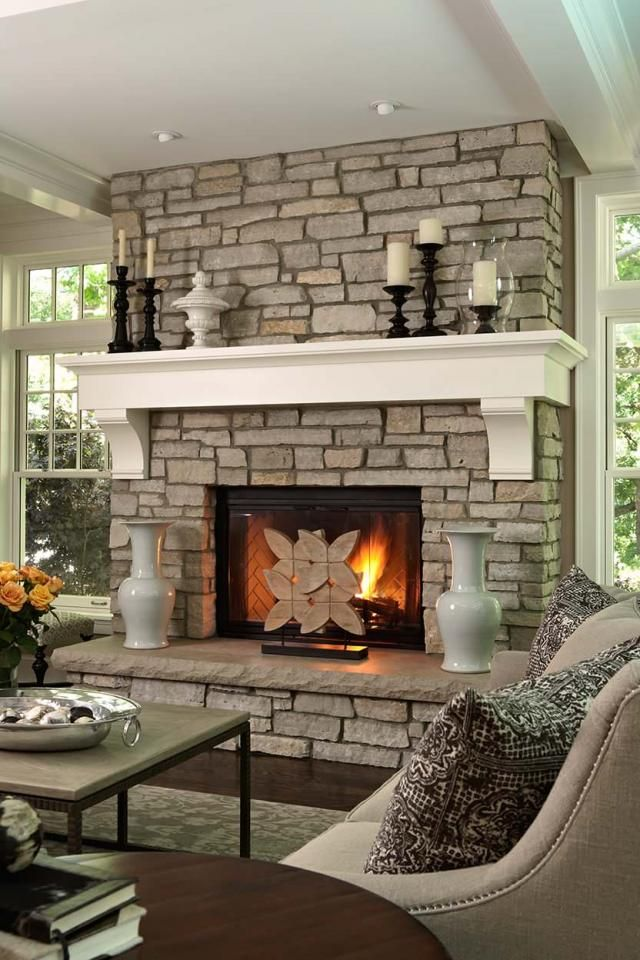 Stone fireplace with white mantle Add the