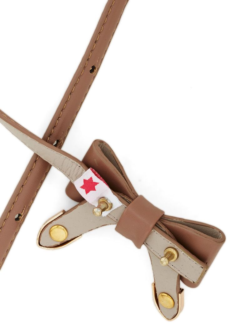 Beauty and Bows Belt. Tie your already-adorable look together by fastening this bow-adorned belt from Kling around your waist! #tan #modcloth