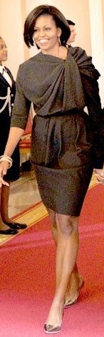 Pear celebrity : Michelle Obama. Although straight skirts are not generally good on pears (straining over and magnifying the hips).... Wearing a blouson top gives a balancing effect. The top structural pleating also draws the eye away from the hip width. But beware of overall enlargement.