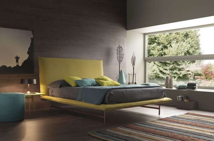 modern bedroom design with yellow bed cover wood floor wood wall with 2 nightstand