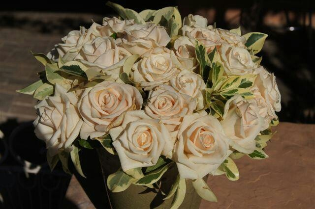 Antique silk roses. .still love these 25 years later
