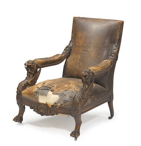An Italian Renaissance Revival walnut and leather library chairthird quarter 19th century