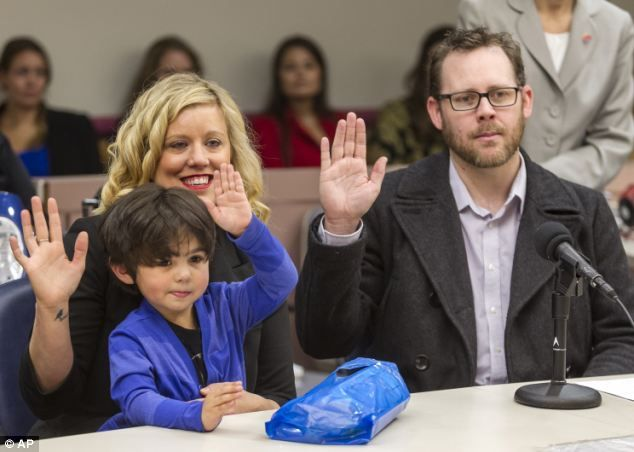 Heartwarming photos of children and their new parents celebrating National Adoption Day