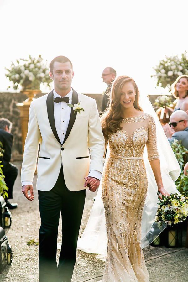 They are newlyweds! Bride in a beautiful non-traditional gold glam wedding dress: http://www.stylemepretty.com/destination-weddings/puerto-rico-weddings/2016/08/26/plaza-la-rogativa-wedding/ Photography: Enuel Viera - http://www.enuelviera.com/