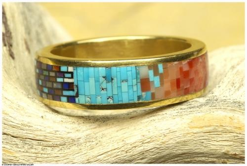 Carl & Irene Clark (Navajo), Female Wedding Band, 1/4 x 7/8 x 7/8 inches, 22 karat gold inlaid with turquoise, lapis, sugilite, coral, and opal. At the Gerald Peters Gallery, Santa Fe, NM.
